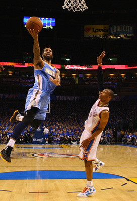 OKLAHOMA CITY, OK - APRIL 20: Wilson Chandler #21 of the Denver Nuggets drives to the basket against Russell Westbrook #0 of the Oklahoma City Thunder in Game Two of the Western Conference Quarterfinals in the 2011 NBA Playoffs on April 20, 2011 at the Fo
