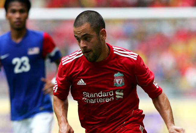 KUALA LUMPUR, MALAYSIA - JULY 16: Joe Cole of Liverpool runs with the ball during the pre-season friendly match between Malaysia and Liverpool at the Bukit Jalil National Stadium on July 16, 2011 in Kuala Lumpur, Malaysia. (Photo by Stanley Chou/Getty Ima