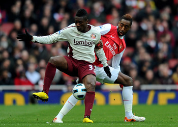LONDON, ENGLAND - MARCH 05:  Asamoah Gyan of Sunderland holds off a challenge from Johan Djourou of Arsenal during the Barclays Premier League match between Arsenal and Sunderland at Emirates Stadium on March 5, 2011 in London, England.  (Photo by Mike He