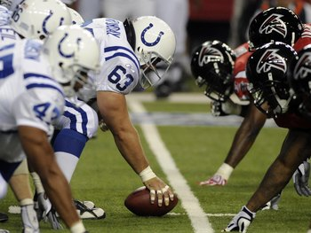 ATLANTA - AUGUST 16: Center Jeff Saturday #63 of the Indianapolis Colts sets for a snap against the Atlanta Falcons at the Georgia Dome on August 16, 2008 in Atlanta, Georgia.   (Photo by Al Messerschmidt/Getty Images)