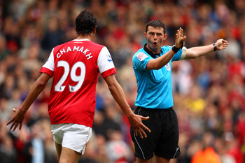 LONDON, ENGLAND - MAY 15:  Marouane Chamakh of Arsenal argues with referee Michael Oliver during the Barclays Premier League match between Arsenal and Aston Villa at the Emirates Stadium on May 15, 2011 in London, England.  (Photo by Richard Heathcote/Get