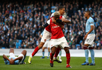 MANCHESTER, ENGLAND - OCTOBER 24:  Alex Song of Arsenal celebrates scoring the second goal during the Barclays Premier League match between Manchester City and Arsenal at City of Manchester Stadium on October 24, 2010 in Manchester, England.  (Photo by Ri