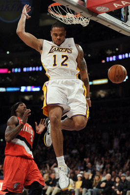 LOS ANGELES, CA - MARCH 20:  Shannon Brown #12 of the Los Angeles Lakers dunks the ball in front of Gerald Wallace #3 of the Portland Trail Blazers at the Staples Center on March 20, 2011 in Los Angeles, California.  NOTE TO USER: User expressly acknowled