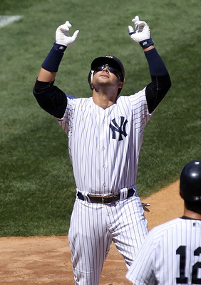 NEW YORK, NY - JULY 30:  Nick Swisher #33 of the New York Yankees celebrates hitting a 2 RBI home run in the fourth inning against the Baltimore Orioles during game one of their double header on July 30, 2011 at Yankee Stadium in the Bronx borough of New