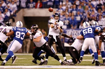 INDIANAPOLIS - JANUARY 16:  Quarterback Joe Flacco #5 of the Baltimore Ravens throws the ball against the Indianapolis Colts in the AFC Divisional Playoff Game at Lucas Oli Stadium on January 16, 2010 in Indianapolis, Indiana.  (Photo by Andy Lyons/Getty