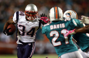 MIAMI - OCTOBER 04:  Running back Sammie Morris #34 of the New England Patriots runs  against the Miami Dolphins at Sun Life Stadium on October 4, 2010 in Miami, Florida.  (Photo by Marc Serota/Getty Images)
