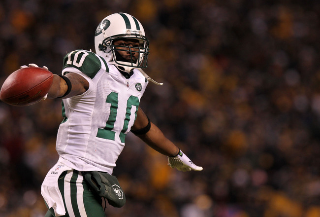 PITTSBURGH, PA - JANUARY 23:  Santonio Holmes #10 of the New York Jets celebrates after he scored a third quarter touchdown against the Pittsburgh Steelers during the 2011 AFC Championship game at Heinz Field on January 23, 2011 in Pittsburgh, Pennsylvani