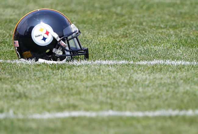 LATROBE, PA - JULY 29:  A Pittsburgh Steelers helmet sits on the practice field during training camp on July 29, 2011 at St Vincent College in Latrobe, Pennsylvania.  (Photo by Jared Wickerham/Getty Images)