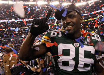 ARLINGTON, TX - FEBRUARY 06:  Donald Lee #86 of the Green Bay Packers celebrates after they defeated the Pittsburgh Steelers 31 to 25 during Super Bowl XLV at Cowboys Stadium on February 6, 2011 in Arlington, Texas.  (Photo by Doug Pensinger/Getty Images)