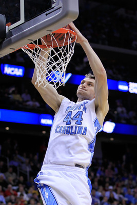 NEWARK, NJ - MARCH 25:  Tyler Zeller #44 of the North Carolina Tar Heels dunks the ball against the Marquette Golden Eagles Tyler Zeller  the east regional semifinal of the 2011 NCAA Men's Basketball Tournament at the Prudential Center on March 25, 2011 i