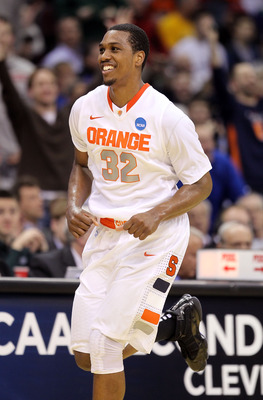 CLEVELAND, OH - MARCH 18: Kris Joseph #32 of the Syracuse Orange smiles after a play against the Indiana State Sycamores during the second round of the 2011 NCAA men's basketball tournament at Quicken Loans Arena on March 18, 2011 in Cleveland, Ohio.  (Ph