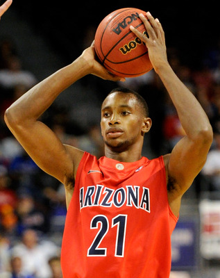 LAS VEGAS - NOVEMBER 27:  Kyle Fogg #21 of the Arizona Wildcats looks to pass against the Kansas Jayhawks during the championship game of the Las Vegas Invitational at The Orleans Arena November 27, 2010 in Las Vegas, Nevada. Kansas won 87-79.  (Photo by 
