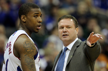 KANSAS CITY, MO - MARCH 10:  Head coach Bill Self of the Kansas Jayhawks speaks with Thomas Robinson #0 during their quarterfinal game against the Oklahoma State Cowboys in the 2011 Phillips 66 Big 12 Men's Basketball Tournament at Sprint Center on March