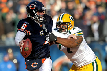 CHICAGO, IL - JANUARY 23:  Quarterback Jay Cutler #6 of the Chicago Bears attempts to avoid a sack by Cullen Jenkins #77 of the Green Bay Packers in the first quarter of the NFC Championship Game at Soldier Field on January 23, 2011 in Chicago, Illinois.