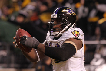 PITTSBURGH, PA - JANUARY 15:  Defensive end Cory Redding #93 of the Baltimore Ravens celebrates after scoring on a fumble by the Pittsburgh Steelers during the AFC Divisional Playoff Game at Heinz Field on January 15, 2011 in Pittsburgh, Pennsylvania.  (P