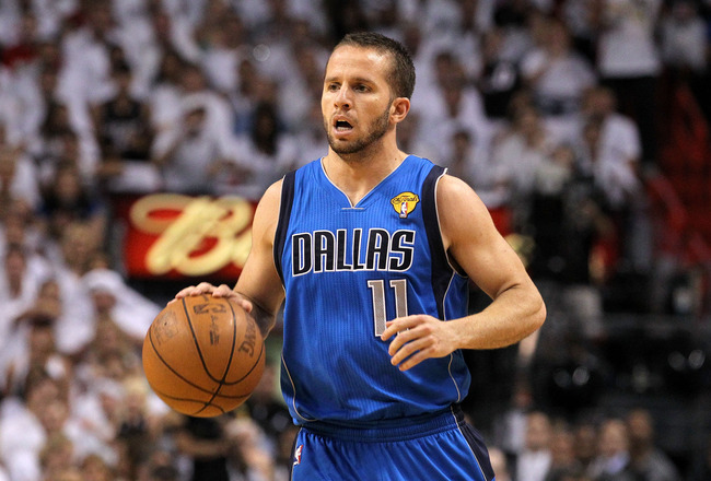 MIAMI, FL - JUNE 12:  Jose Juan Barea #11 of the Dallas Mavericks brings the ball up court against the Miami Heat in Game Six of the 2011 NBA Finals at American Airlines Arena on June 12, 2011 in Miami, Florida. The Mavericks won 105-95. NOTE TO USER: Use