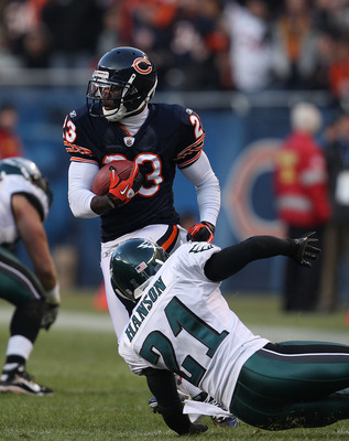CHICAGO - NOVEMBER 28: Devin Hester #23 of the Chicago Bears moves around Joselio Hanson #21 of the Philadelphia Eagles during a first down run at Soldier Field on November 28, 2010 in Chicago, Illinois. The Bears defeated the Eagles 31-26. (Photo by Jona