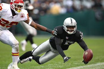 OAKLAND, CA - NOVEMBER 07:  Johnnie Lee Higgins #15 of the Oakland Raiders misses a pass against Eric Berry #29 of the Kansas City Chiefs during an NFL game at Oakland-Alameda County Coliseum on November 7, 2010 in Oakland, California.  (Photo by Jed Jaco
