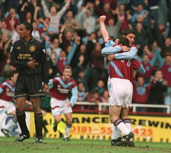 14 MAY 1995:  MICHAEL HUGHES OF WEST HAM UNITED CELEBRATES WITH HIS TEAMMATE TREVOR MORLEY AS PAUL INCE OF MANCHESTER UNITED LOOKS ON DURING THEIR FA CARLING PREMIERSHIP MATCH AT UPTON PARK IN LONDON. Mandatory Credit: See Caption/ALLSPORT
