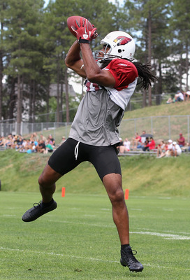 FLAGSTAFF, AZ - JULY 31:  Wide receiver Larry Fitzgerald #11 of the Arizona Cardinals makes a leaping reception in the team training camp at Northern Arizona University on July 31, 2011 in Flagstaff, Arizona.  (Photo by Christian Petersen/Getty Images)