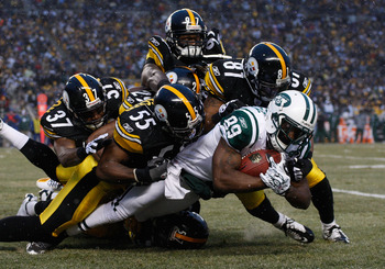 PITTSBURGH - DECEMBER 19:  Members of the Pittsburgh Steelers special teams including Jason Worilds #97, Ryan Mundy #29, Anthony Madison #37, Stevenson Sylvester #55, and Arnaz Battle #81 make a tackle on Jerricho Cotchery #89 of the New York Jets during