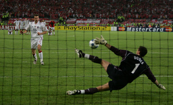 ISTANBUL, TURKEY - MAY 25:  Liverpool goalkeeper Jerzy Dudek of Poland saves the decisive penalty from AC Milan forward Andriy Shevchenko of Ukraine during a penalty shoot out during the European Champions League final between Liverpool and AC Milan on Ma