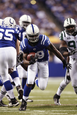 INDIANAPOLIS, IN - DECEMBER 27: Joseph Addai #29 of the Indianapolis Colts runs for a 21-yard touchdown in the first quarter against the New York Jets at Lucas Oil Stadium on December 27, 2009 in Indianapolis, Indiana. (Photo by Joe Robbins/Getty Images)