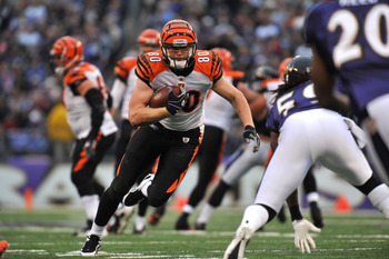 BALTIMORE, MD - JANUARY 2:  Chase Coffman #80 of the Cincinnati Bengals runs the ball against the Baltimore Ravens at M&T Bank Stadium on January 2, 2011 in Baltimore, Maryland. The Ravens defeated the Bengals 13-6. (Photo by Larry French/Getty Images)