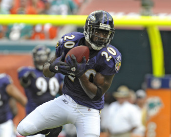 MIAMI, FL - JANUARY 4:  Safety Ed Reed #20 of the Baltimore Ravens intercepts a pass against the Miami Dolphins in an AFC wild card game at Dolphins Stadium January 4, 2009 in Miami, Floirda.  Reed ran the interception back for a touchdown. (Photo by Al M