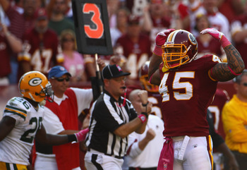 LANDOVER, MD - OCTOBER 10:  Fullback Mike Sellers #45 of the Washington Redskins flexes after officials called a penalty on a key third down play in overtime against the Green Bay Packers at FedExField on October 10, 2010 in Landover, Maryland. The Redski