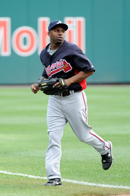 WASHINGTON, DC - AUGUST 01:  Michael Bourn #24 of the Atlanta Braves warms up before the game against the Washington Nationals at Nationals Park on August 1, 2011 in Washington, DC.  (Photo by Greg Fiume/Getty Images)