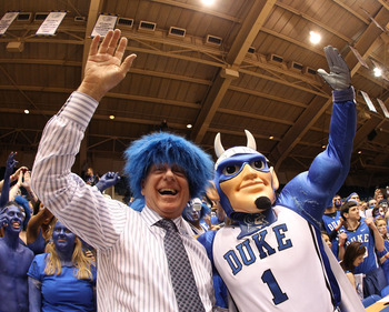 DURHAM, NC - MARCH 06:  ESPN analyst Dick Vitale celebrates with the Cameron Crazies before the start of the game between the North Carolina Tar Heels and Duke Blue Devils at Cameron Indoor Stadium on March 6, 2010 in Durham, North Carolina.  (Photo by St