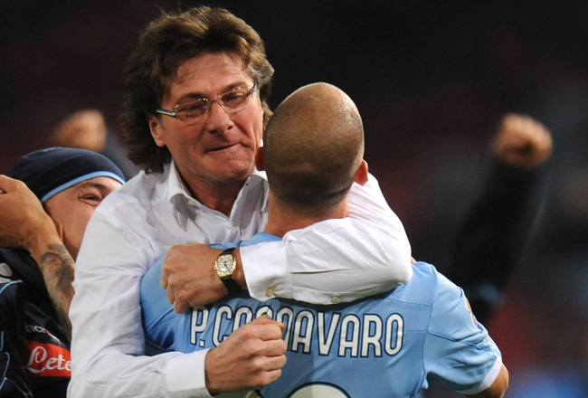 NAPLES, ITALY - DECEMBER 06: Walter Mazzarri coach of Napoli celebrates with Paolo Cannavaro the Christian Maggio's opening goal during the Serie A match between Napoli and Palermo at Stadio San Paolo on December 6, 2010 in Naples, Italy.  (Photo by Tulli