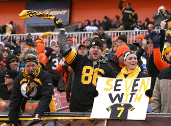 CLEVELAND, OH - JANUARY 02:  Fans of the Pittsburgh Steelers celebrate during their game against the Cleveland Browns at Cleveland Browns Stadium on January 2, 2011 in Cleveland, Ohio.  (Photo by Matt Sullivan/Getty Images)