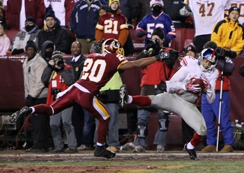 LANDOVER, MD - DECEMBER 21:  Steve Smith #12 of the New York Giants catches a six-yard touchdown pass against Justin Tryon #20 of the Washington Redskins in the second quarter at FedEx Field on December 21, 2009 in Landover, Maryland. (Photo by Al Bello/G
