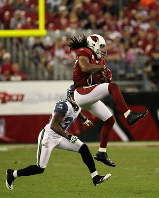 GLENDALE, AZ - NOVEMBER 14:  Wide receiver Larry Fitzgerald #11 of the Arizona Cardinals makes a catch in front of safety Lawyer Milloy #36 of the Seattle Seahawks at University of Phoenix Stadium on November 14, 2010 in Glendale, Arizona. Seattle won 36-