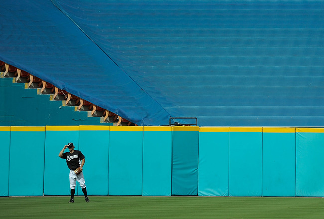 MIAMI GARDENS, FL - JULY 22: Bryan Petersen #16 of the Florida Marlins catches fly balls in deep center field during batting practice before a game against the New York Mets at Sun Life Stadium on July 22, 2011 in Miami Gardens, Florida.  (Photo by Sarah