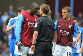 BIRMINGHAM, ENGLAND - MAY 07:  Emile Heskey of Aston Villa argues with referee Mike Jones as team mate Stiliyan Petrov looks on during the Barclays Premier League match between Aston Villa and Wigan Athletic on May 7, 2011 in Birmingham, England.  (Photo