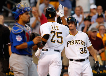 PITTSBURGH - AUGUST 01:  Derrek Lee #25 of the Pittsburgh Pirates, newly acquired in a trade from the Baltimore Orioles, is congratulated by teammate Ryan Ludwick #36, also just acquired in a trade from the San Diego Padres, after Lee hit a solo home run