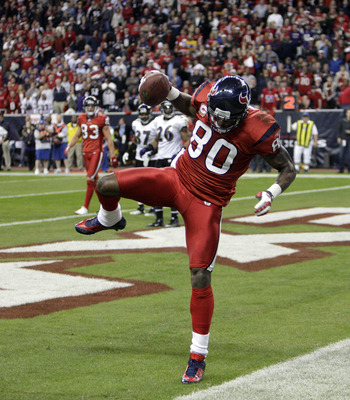 HOUSTON, TX - DECEMBER 13:  Wide receiver Andre Johnson #80 of the Houston Texans comes scores as he get's his foot down in the endzone in the fourth quarter against the Baltimore Ravens at Reliant Stadium on December 13, 2010 in Houston, Texas. Baltimore