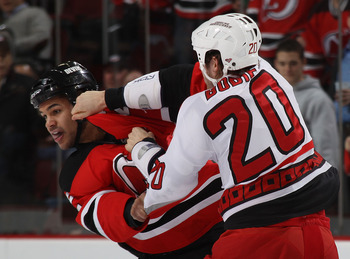 NEWARK, NJ - FEBRUARY 16: Troy Bodie #20 of the Carolina Hurricanes and Mark Fraser #2 of the New Jersey Devils fight during the first period at the Prudential Center on February 16, 2011 in Newark, New Jersey.  (Photo by Bruce Bennett/Getty Images)