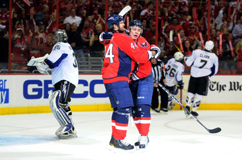 WASHINGTON, DC - APRIL 29:  Alexander Semin #28 of the Washington Capitals celebrates with Jason Arnott #44 after scoring in the first period against Dwayne Roloson #35 of the Tampa Bay Lightning during Game One of the Eastern Conference Semifinal during