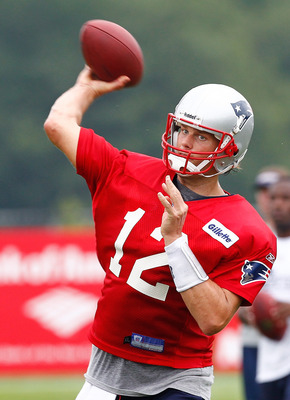 FOXBOROUGH, MA  - JULY 29:  Tom Brady #12  of the New England Patriots participates during the afternoon session of training camp at Gillette Stadium on July 29, 2011 in Foxborough, Massachusetts.  (Photo by Jim Rogash/Getty Images)