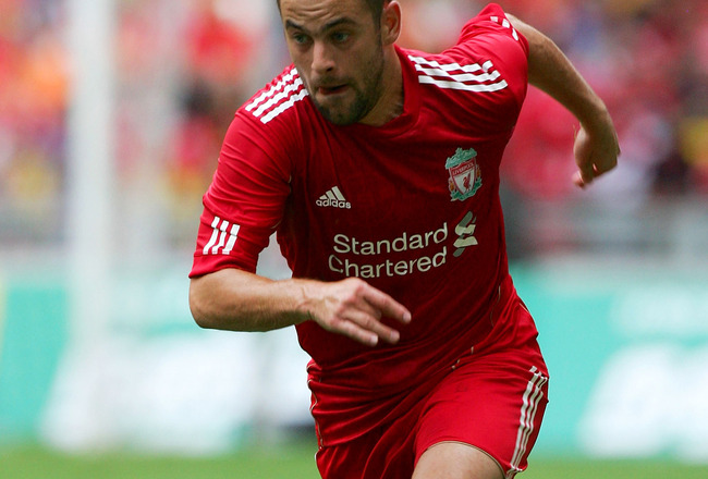 KUALA LUMPUR, MALAYSIA - JULY 16: Joe Cole of Liverpool in action during the pre-season friendly match between Malaysia and Liverpool at the Bukit Jalil National Stadium on July 16, 2011 in Kuala Lumpur, Malaysia. (Photo by Stanley Chou/Getty Images)