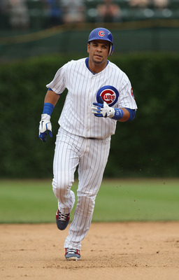 CHICAGO, IL - JULY 01:  Aramis Ramirez #16 of the Chicago Cubs runs the bases after hitting the 300th home run of his career against the Chicago White Sox at Wrigley Field on July 1, 2011 in Chicago, Illinois. The White Sox defeated the Cubs 6-4.  (Photo