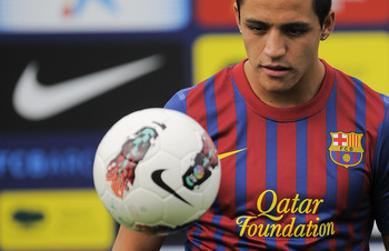 BARCELONA, SPAIN - JULY 25:  Alexis Sanchez from Chile controls the ball during his presentation as the new signing for FC Barcelona at the Joan Gamper training camp sports complex on July 25, 2011 in Barcelona, Spain.  (Photo by David Ramos/Getty Images)
