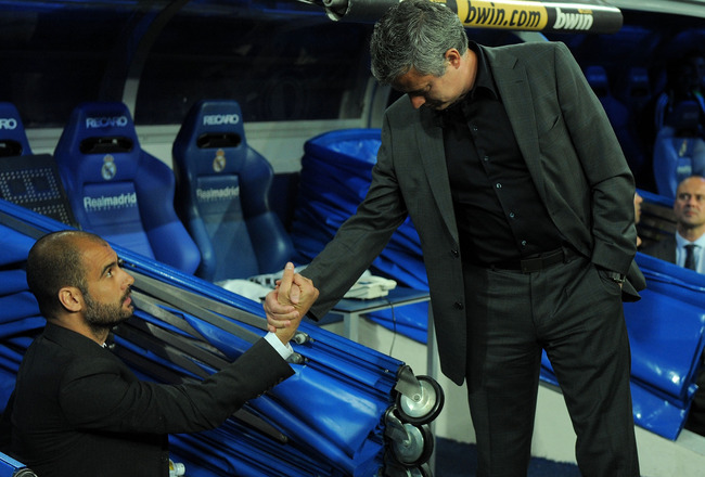 MADRID, SPAIN - APRIL 16: Barcelona manager (L) Josep Guardiola shakes hands with head coach Jose Mourinho of Real Madrid before the start of the La Liga match between Real Madrid and Barcelona at Estadio Santiago Bernabeu on April 16, 2011 in Madrid, Spa
