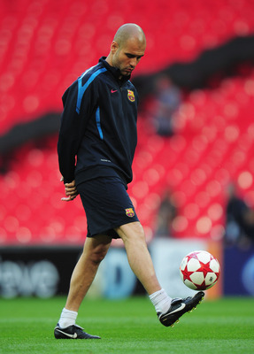 LONDON, ENGLAND - MAY 27:  Josep Guardiola manager of FC Barcelona controls the ball during a Barcelona training session prior to the UEFA Champions League final versus Manchester United at Wembley Stadium on May 27, 2011 in London, England.  (Photo by Sh