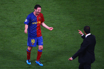ROME - MAY 27: Lionel Messi of Barcelona celebrates with his coach, Josep Guardiola after Barcelona won 2-0 during the UEFA Champions League Final match between Barcelona and Manchester United at the Stadio Olimpico on May 27, 2009 in Rome, Italy.  (Photo