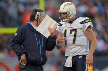 DENVER - JANUARY 02:  Head coach Norv Turner talks with quarterback Philip Rivers #17 of the San Diego Chargers as they face the Denver Broncos at INVESCO Field at Mile High on January 2, 2011 in Denver, Colorado. The Chargers defeated the Broncos 33-28.
